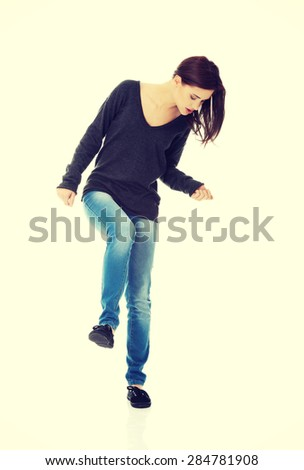 Pretty young woman dancing and laughing - stock photo