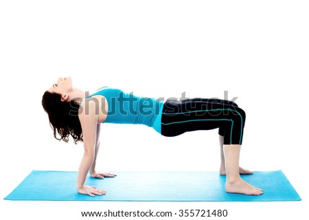 Pretty young woman doing exercises on the mat