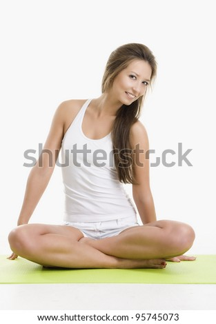 Pretty young woman doing yoga