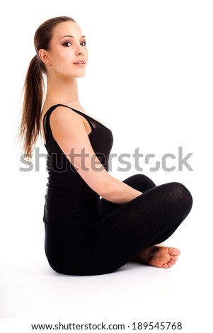 pretty young woman doing yoga exercise, white background - stock photo