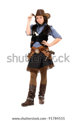 Pretty young woman dressed as a cowboy. Isolated on white