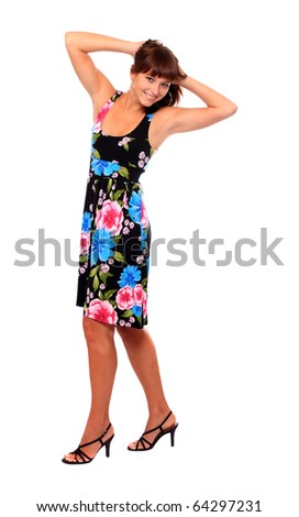 Pretty young woman dressed in luxury evening dress. Fashion shot, great for calendar. - stock photo