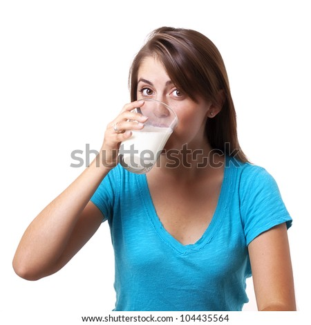 pretty young woman drinking milk - stock photo