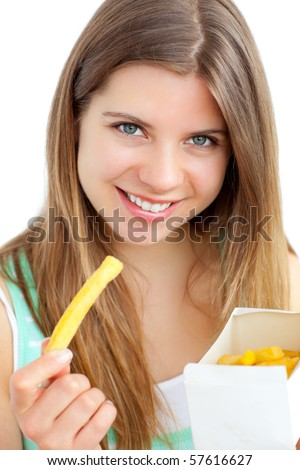 Pretty young woman eating chips - stock photo