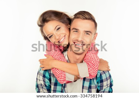 Pretty young woman embracing her boyfriend - stock photo