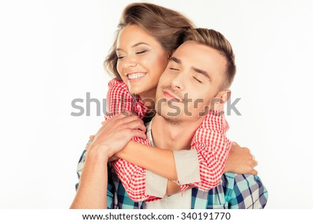 Pretty young woman embracing her boyfriend closing eyes - stock photo