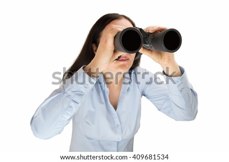 Pretty young woman entrepreneur looking through binoculars searching business and employment opportunities  - stock photo