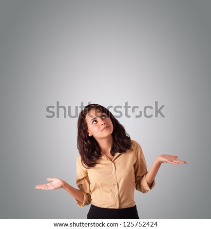 pretty young woman gesturing with copy space - stock photo