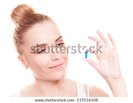pretty young woman holding a blue pill, isolated against white background