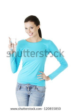 Pretty young woman holding a glass of water , isolated on white - stock photo