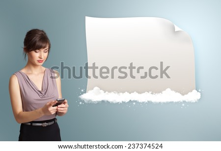 pretty young woman holding a phone and presenting modern copy space on clouds - stock photo