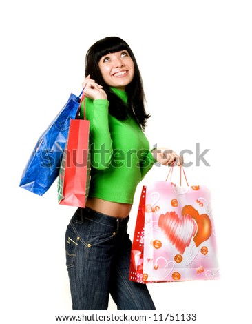 Pretty young woman holding bags on a white background