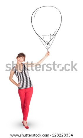 Pretty young woman holding balloon drawing