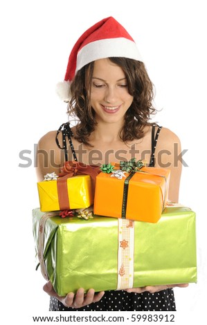Pretty young woman holding christmas gifts, isolated on white background.