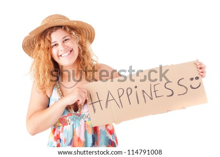 Pretty young woman holding happiness card - stock photo