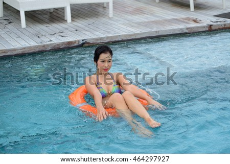 Pretty young woman in a swimming pool.