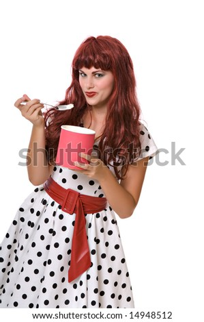 Pretty young woman in a wig eats ice cream isolated against white background