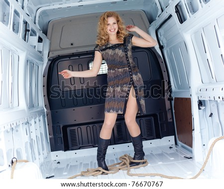 Pretty young woman in cargo van inside