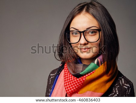 Pretty young woman in glasses