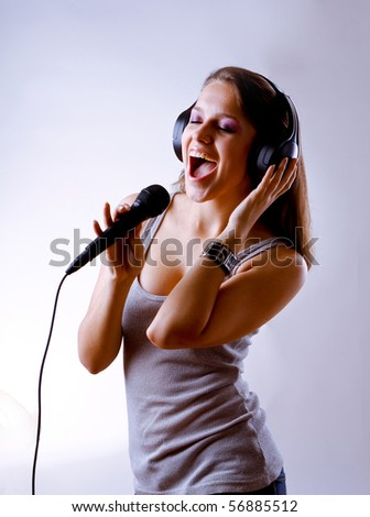 pretty young woman in headphones - stock photo