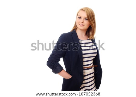 Pretty young woman in jacket and striped dress - stock photo