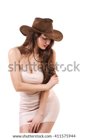 Pretty young woman in light pink dress and cowboy hat isolated on white background - stock photo