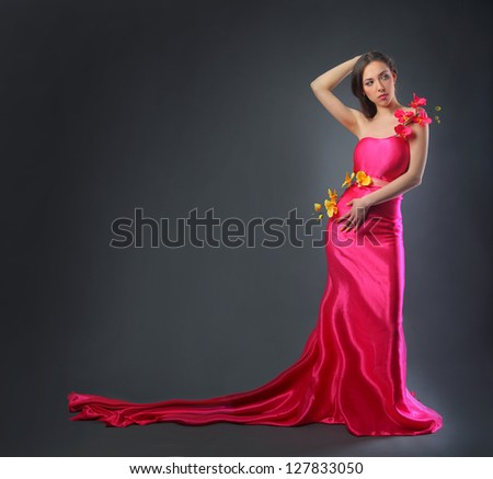 pretty young woman in pink long dress - stock photo