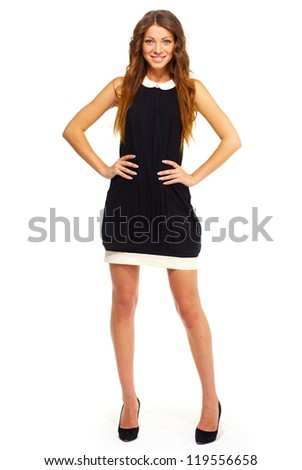 Pretty young woman in simple black dress isolated on white - stock photo