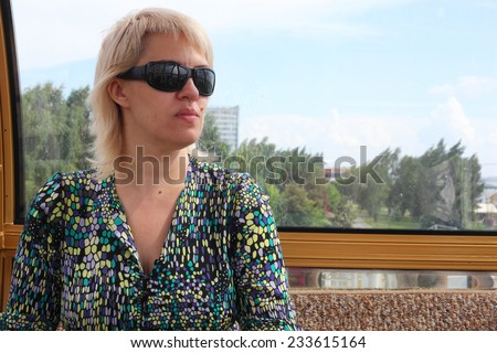 pretty young woman in the ferris wheel cabin  - stock photo
