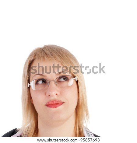 pretty young woman in the glasses looking up and dreaming - stock photo