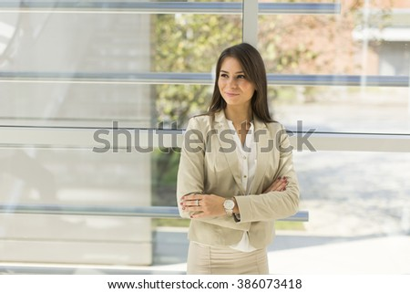Pretty young woman in the modern office - stock photo