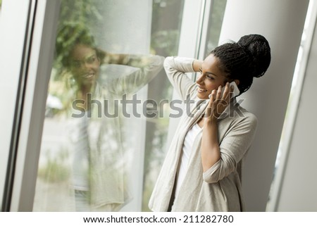 Pretty young woman in the office - stock photo