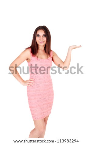pretty young woman in the pink dress showing something