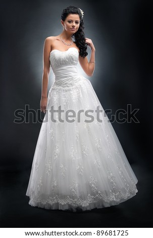 Pretty young woman in white wedding dress with flower in her head - series of photos - stock photo