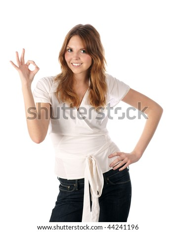 Pretty young woman indicating ok sign - stock photo