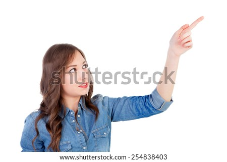 Pretty young woman indicating something with the finger isolated on a white background