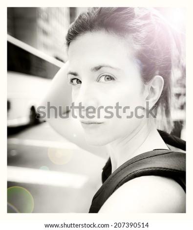 Pretty young woman Instagram style street portrait - stock photo
