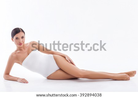 Pretty young woman is relaxing at spa - stock photo
