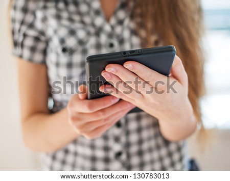 Pretty young woman is using a Tablet PC