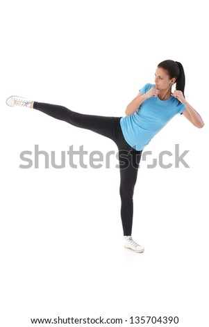 Pretty young woman kick-boxing. - stock photo