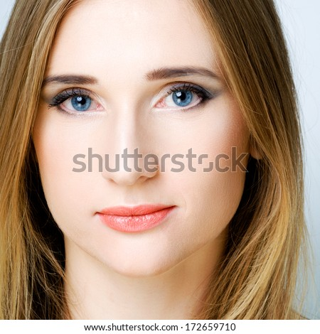 Pretty young woman on gray background - stock photo