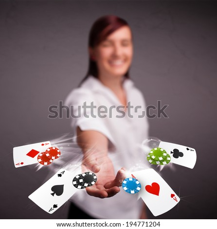 Pretty young woman playing with poker cards and chips  - stock photo
