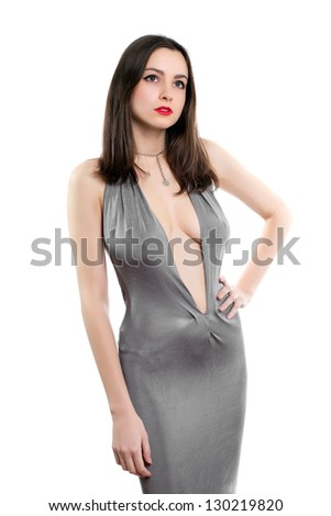 Pretty young woman posing in sexy grey dress. Isolated on white - stock photo