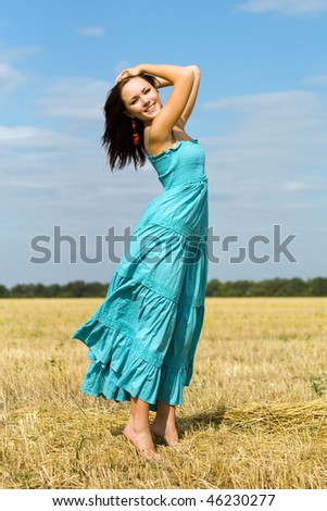 Pretty young woman posing in the field - stock photo