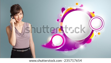 Pretty young woman presenting abstract speech bubble copy space and making phone call - stock photo