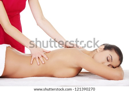 Pretty young woman relaxing beeing massaged in spa saloon - stock photo