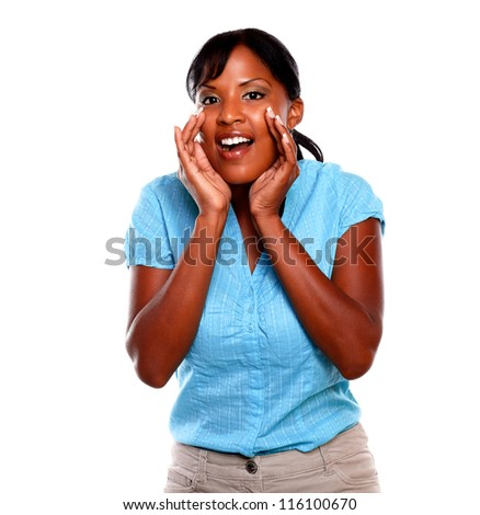 Pretty young woman screaming and looking at you on blue blouse against white background - stock photo
