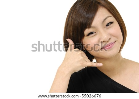 pretty young woman showing us a call me sign - stock photo
