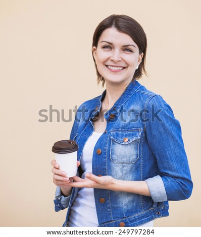 Pretty young woman smiling - stock photo