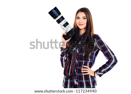 Pretty young woman taking pictures on the camera. Isolated over white. - stock photo